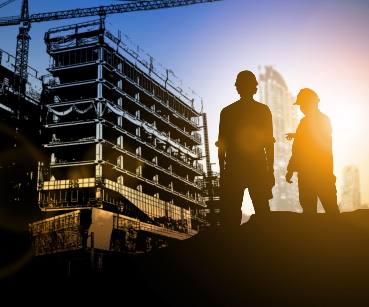 Silhouette,Businessman,Engineer,Looking,Blueprint,In,A,Building,Site,Over